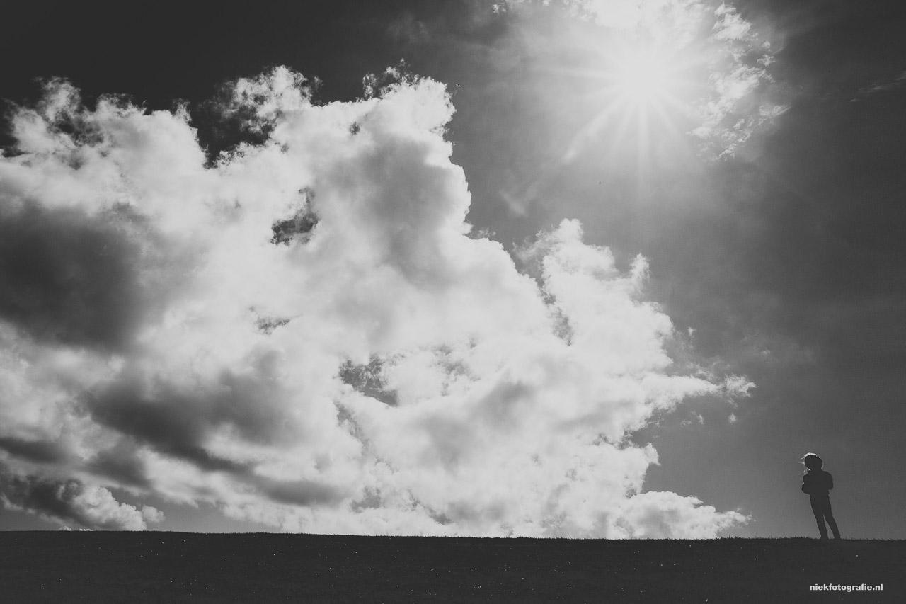 Tegenlicht portret met wolken en zon